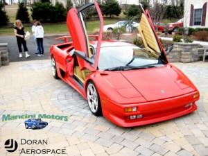 Lamborghini doors. Amazing. Front left view.